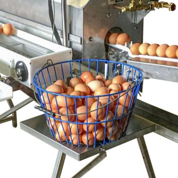 Drop down egg basket on a Power Scrub Egg Washer