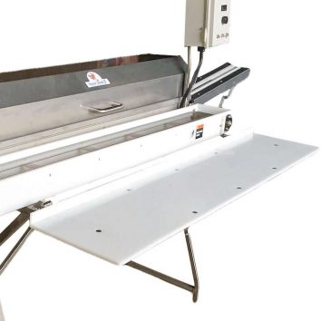 Drop down packing table on a Power Scrub Egg Washer
