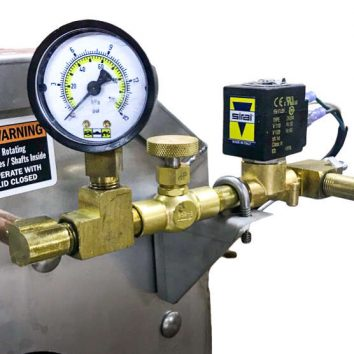 Metering gauge on a Power Scrub Egg Washer automatically shuts off water